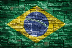 National flag of Brazil on stone  wall background.The concept of national pride and symbol of the country. Flag  banner on  stone texture background.