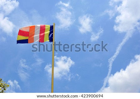 national flag of buddhism on sky  at thailand #423900694
