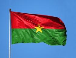 National flag of Burkina Faso on a flagpole