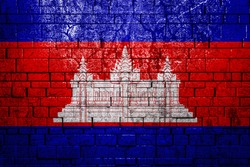 National flag of Cambodia on brick  wall background.The concept of national pride and symbol of the country. Flag  banner on  stone texture background.