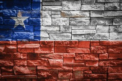 National flag of Chile on stone  wall background.The concept of national pride and symbol of the country. Flag  banner on  stone texture background.
