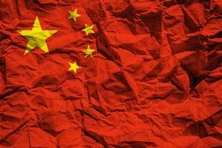 National flag of China on crumpled paper. Flag printed on a sheet. Flag image for design on flyers, advertising.