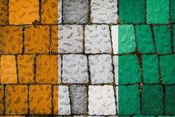 National flag of Cote d'ivoire on stone  wall background. Flag  banner on  stone texture background.