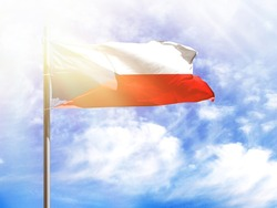 National flag of Czech Republic on a flagpole in front of blue sky