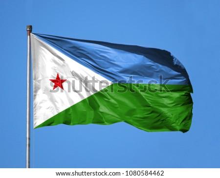 National flag of Djibouti on a flagpole #1080584462