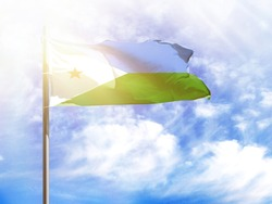 National flag of Djibouti on a flagpole in front of blue sky