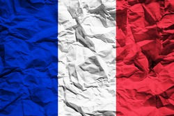 National flag of France on crumpled paper. Flag printed on a sheet. Flag image for design on flyers, advertising.