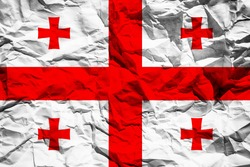 National flag of Georgia on crumpled paper. Flag printed on a sheet. Flag image for design on flyers, advertising.