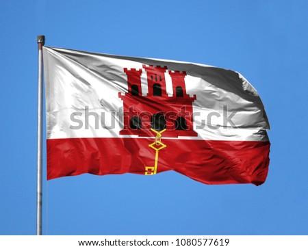 National flag of Gibraltar on a flagpole #1080577619