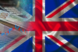 national flag of Great Britain on satin, dollar bills, computer, concept of global trading on the stock exchange, falling and rising prices for world currency