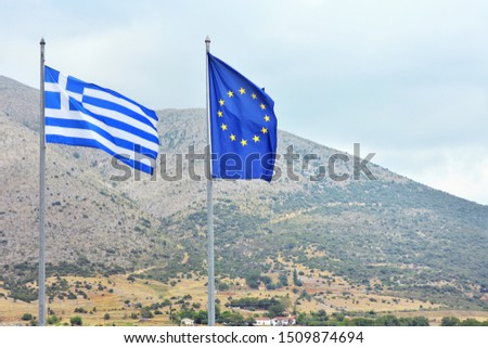 National Flag Of Greece with European Flag greek on mountains background. Flag of Greece and EU flag on flagpoles. Patriotic symbol of Greece. Euro zone.  #1509874694