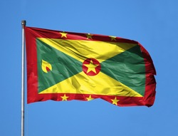 National flag of Grenada on a flagpole