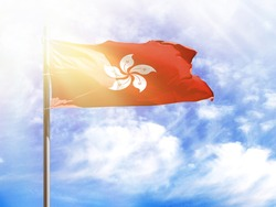 National flag of Hong Kong on a flagpole in front of blue sky
