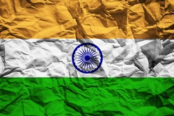 National flag of India on crumpled paper. Flag printed on a sheet. Flag image for design on flyers, advertising.