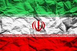 National flag of Iran on crumpled paper. Flag printed on a sheet. Flag image for design on flyers, advertising.