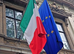 National flag of Italy and European Union (EU) on the building