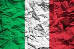 National flag of Italy on crumpled paper. Flag printed on a sheet. Flag image for design on flyers, advertising.