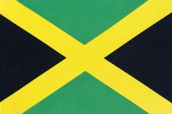 National flag of Jamaica close-up on fabric base