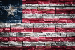National flag of Liberia on stone  wall background.The concept of national pride and symbol of the country. Flag  banner on  stone texture background.
