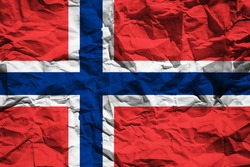 National flag of Norway on crumpled paper. Flag printed on a sheet. Flag image for design on flyers, advertising.