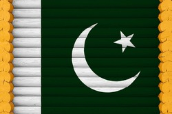National flag  of Pakistan on a wooden wall background. The concept of national pride and a symbol of the country. Flags painted on a house