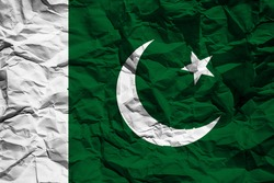 National flag of Pakistand on crumpled paper. Flag printed on a sheet. Flag image for design on flyers, advertising.