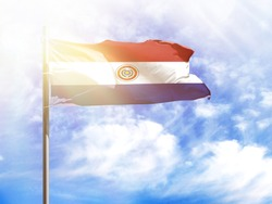 National flag of Paraguay on a flagpole in front of blue sky