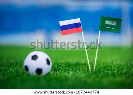 National flag of Russia and Saudi Arabia on Football pitch. Football ball on green grass.  #1077440774