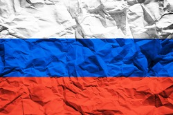 National flag of Russia on crumpled paper. Flag printed on a sheet. Flag image for design on flyers, advertising.