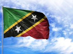 National flag of Saint Kitts and Nevis on a flagpole