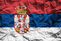 National flag of Serbia on crumpled paper. Flag printed on a sheet. Flag image for design on flyers, advertising.