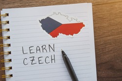 national flag of the Czech Republic, a notebook with the inscription learn Czech, the concept of education and learning foreign languages