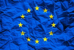 National flag of the European Union on crumpled paper. Flag printed on a sheet. Flag image for design on flyers, advertising.