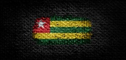 National flag of the Togo on dark fabric