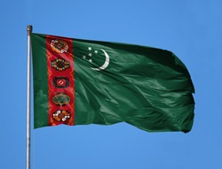 National flag of Turkmenistan on a flagpole