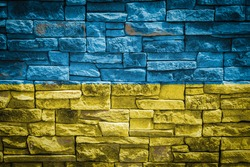 National flag of Ukraine on stone  wall background.The concept of national pride and symbol of the country. Flag  banner on  stone texture background.