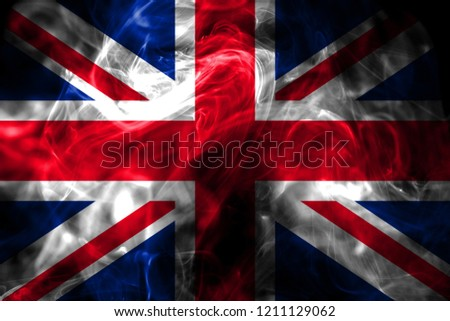 National flag of United Kingdom made from colored smoke isolated on black background. Abstract silky wave background. #1211129062