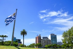National flag of Uruguay flying in Tres Cruces district of Montevideo, Uruguay. Montevideo is the capital and largest city of Uruguay.