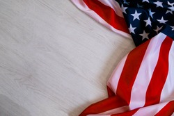 national flag of USA. Natural light. Selective focus. Close up on a gray background. Top view, flat lay. copy space