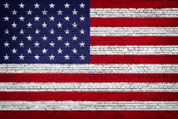National flag of USA on a brick background