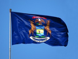 National flag State of Michigan on a flagpole