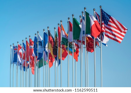 national flags of various countries flying in the wind #1162590511
