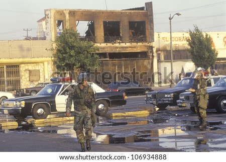 National Guardsmen and police cars patrolling during 1992 riots, South Central Los Angeles, California