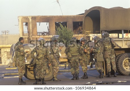 National Guardsmen taking meal break, 1992 riots, South Central Los Angeles, California