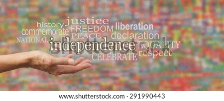 National Independence Day Banner - female\'s open palm with the word \'independence\' above surrounded by relevant word cloud on a stone effect background and blurred colors depicting flags of the world