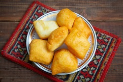 National Kazakh pastries baursaki in a plate on a wooden background