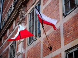 national mourning after the tragic death of the president of Gdańsk. The state flags were lowered to the half mast. The coffin with the body of Paweł Adamowicz was moved to the Gdańsk St. Mary's Basil