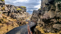 National park of Iceland Thingvellir. The park lies in a rift valley that marks the crest of the Mid-Atlantic Ridge and the boundary between the North American and Eurasian tectonic plates.