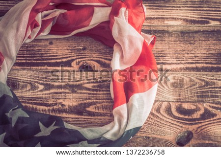 National Patriotic symbols. American flag on an old wooden background.The concept of patriotism and celebration #1372236758