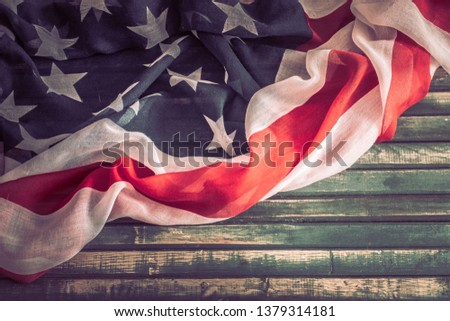 National Patriotic symbols. American flag on an old wooden background.The concept of patriotism and celebration #1379314181